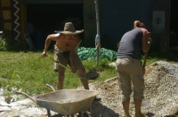 Tanya and Sam moving sand and gravel